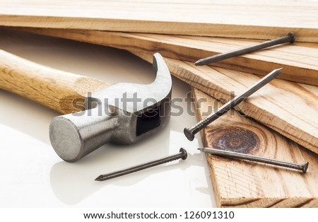 Wood planks with hammer and nails on white background - stock photo