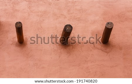 Wood poles in an old red clay adobe home