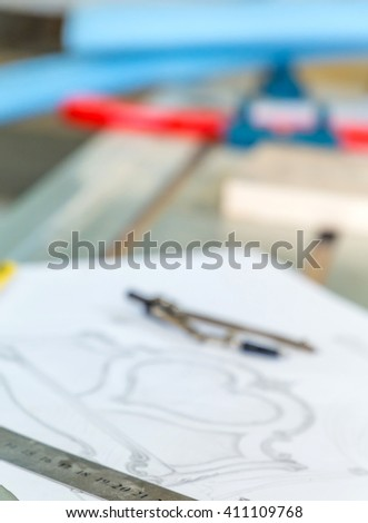 Wood processing. Joinery work. vintage pencil, compass, ruler and sketch by hand,  Wood Carving. blurred - stock photo