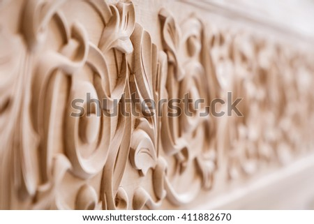 Wood processing. Joinery work. wood carving. decorative, abstract, floral ornament. Pattern of flower carved on wood background. use as background - stock photo