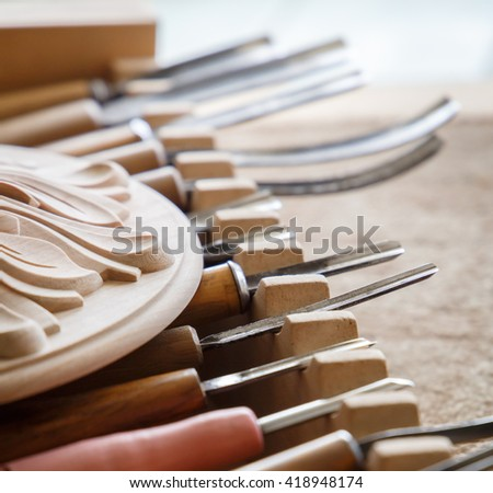 Wood processing. Joinery work. wood carving. the carving object with pattern, chisels for carving close up. small depth of field. use as background - stock photo