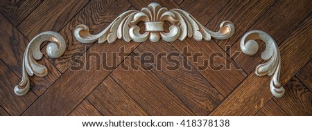 Wood processing. Joinery work. woodcarving. carved detail on a wooden background. used as background - stock photo