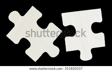 Wood Puzzle piece on black background closeup