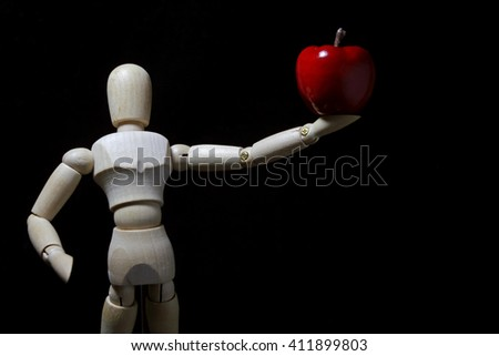 wood robot and  mini   apple in action .