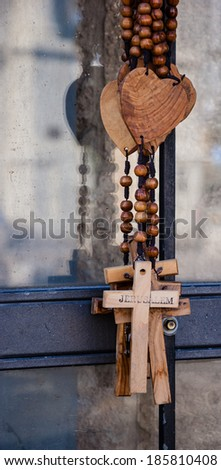 Wood rosary with the heart and the cross with inscription JERUSALEM. Closeup. Aged photo. - stock photo