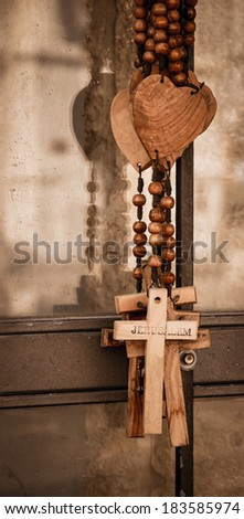 Wood rosary with the heart and the cross with inscription JERUSALEM. Closeup. Aged photo. Sepia. - stock photo