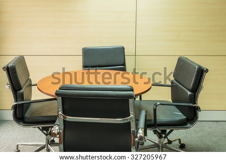wood round table for meeting in manager room background