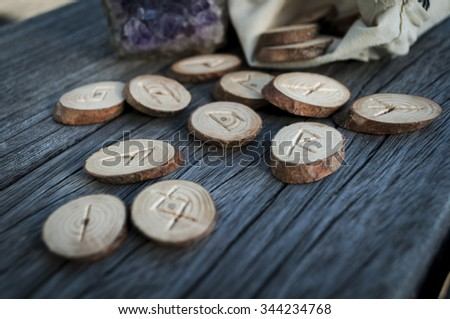 wood runes handmade on an old wooden table. Esoteric subjects