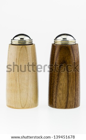 Wood salt and pepper shakers on a white background. - stock photo