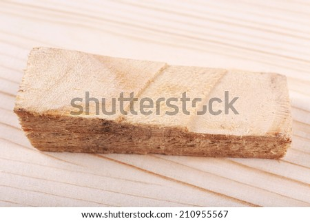 Wood shavings on wooden background
