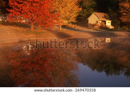 Wood shed on lake in autumn, Connecticut - stock photo