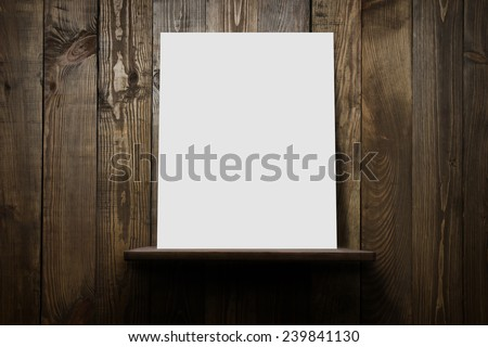 Wood shelf, grunge industrial interior, concrete wall with shelf and blank poster - stock photo