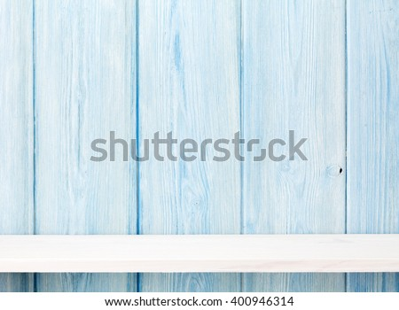 Wood shelf in front of wooden wall. View with copy space - stock photo