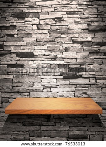 Wood shelf on stone wall with down light