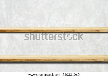 Wood shelves on cement wall. - stock photo