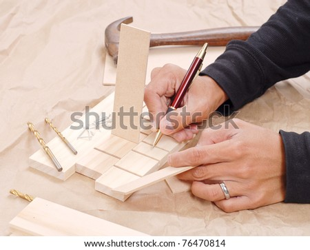 Wood Shop Worker Labeling Parts - stock photo