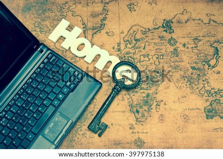 Wood Sign Home, Old Big Key, Laptop With Black Blank Screen on The Old Map, With Different Effect, Flat Lay, Top View - stock photo