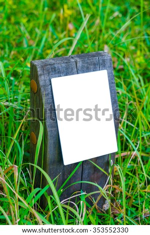 Wood sign on grass - stock photo