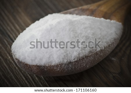 wood spoon of baking soda close up on table  - stock photo