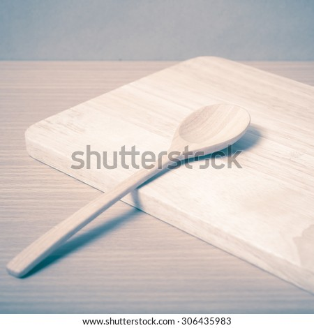 wood spoon with cutting board on table background vintage style