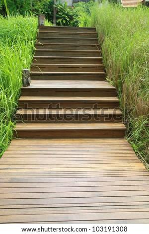 wood stair way on green garden - stock photo