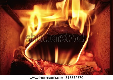 wood stove burning in a private house - stock photo