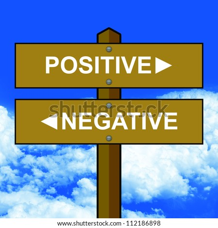 Wood Style Street Sign Pointing to Positive and Negative in Blue Sky Background For Selection Concept - stock photo