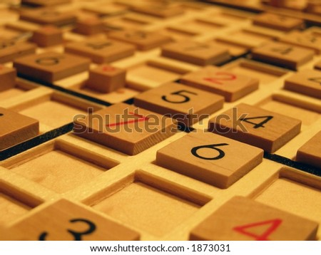 Wood sudoku board and tiles.