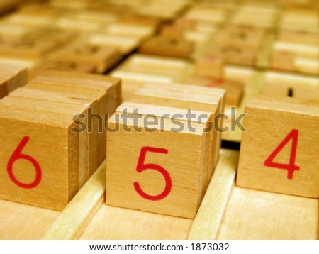 Wood sudoku board and tiles. - stock photo