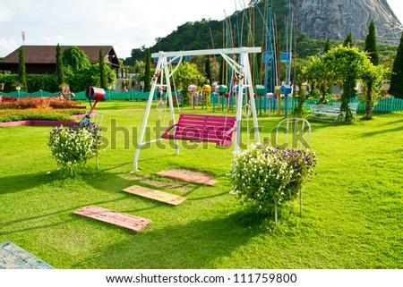 wood swing chair in the garden greenSONY DSC - stock photo