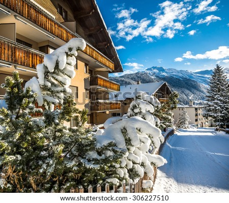 Wood swiss chalet in  the morning sun light in Davos, Switzerland. - stock photo