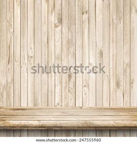 Wood table and bright wooden wall background - stock photo
