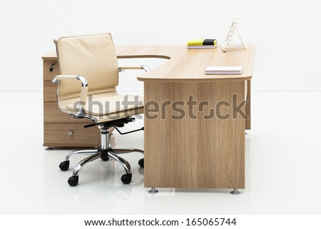 wood table and chair on a white wall - stock photo