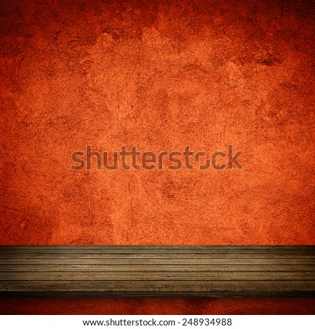 Wood table and red concrete wall background