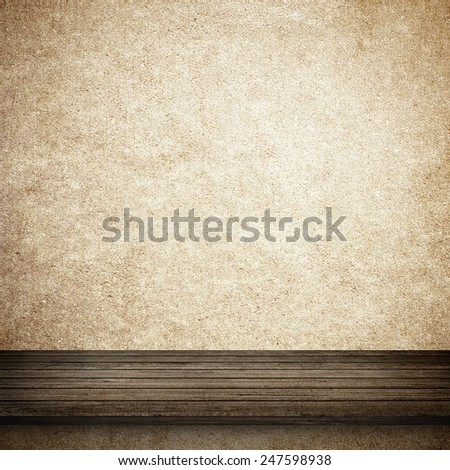 Wood table and yellow or orange concrete wall background - stock photo