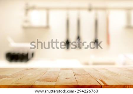 Wood table top  as kitchen island  on blur kitchen background   can be used. Kitchen Table Stock Images  Royalty Free Images   Vectors