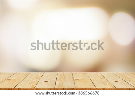 Wood table top on blur background - can be used for display or montage your products - stock photo