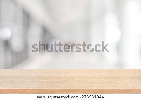 Wood table top on blurred hallway background - can be used for display or montage your products - stock photo