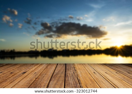 Wood table top on blurred sunset background - can be used for display or montage your products