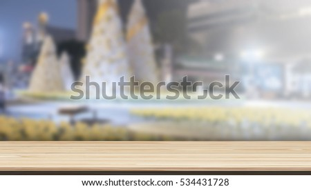 Wood table top on bokeh background from decorated Christmas tree, panoramic banner - can be used for display or montage your products