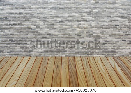 Wood table top on brick wall background - stock photo