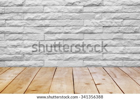 Wood table top on bricks wall. - stock photo