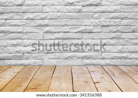 Wood table top on bricks wall. - stock photo