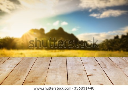 Wood table top on green background. - stock photo