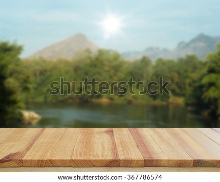 Wood table top on nature scenery background - stock photo