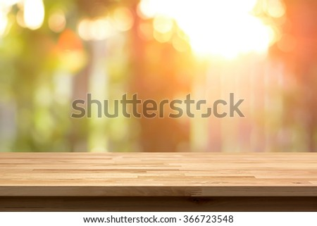 Wood table top on shiny bokeh abstract background - can used for display or montage your products - stock photo