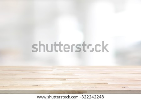Wood table top on white blurred abstract background from building hallway  - can be used for display or montage your products - stock photo