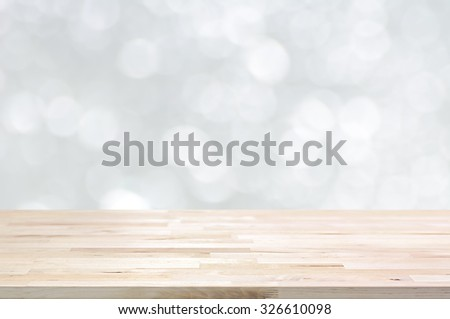 Wood table top on white bokeh abstract background - can be used for montage or display your products - stock photo