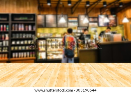 Wood table top with Blur background  coffee shop- can be used for montage or display your products - stock photo