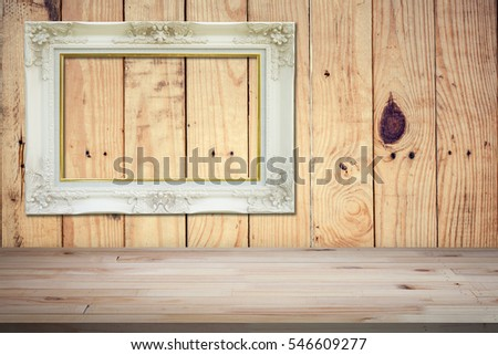 Wood table top, wood shelf with wood background and white frame